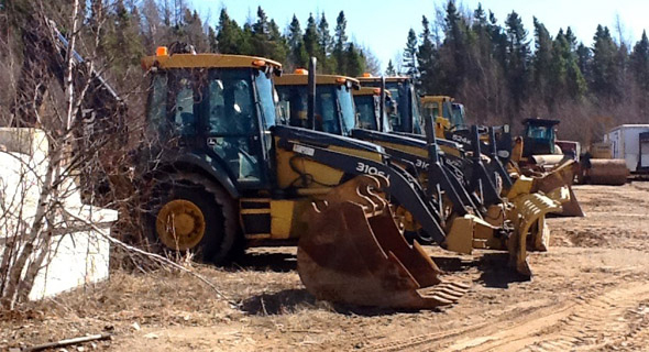 Excavators in a row